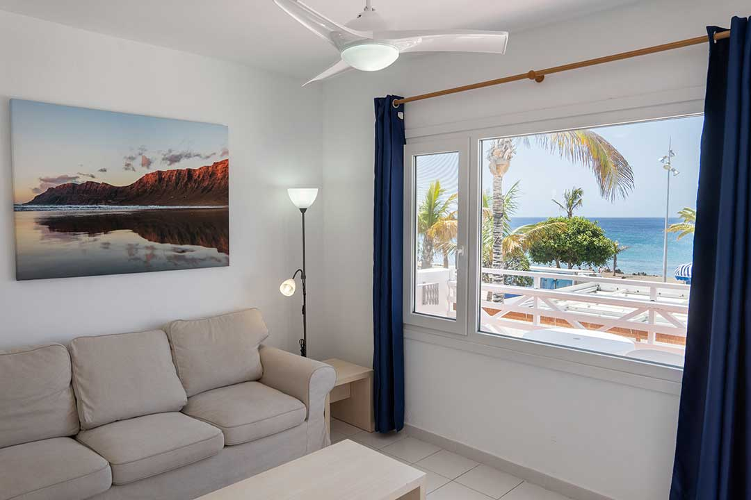 Living room, sofa bed, window overlooking the sea.